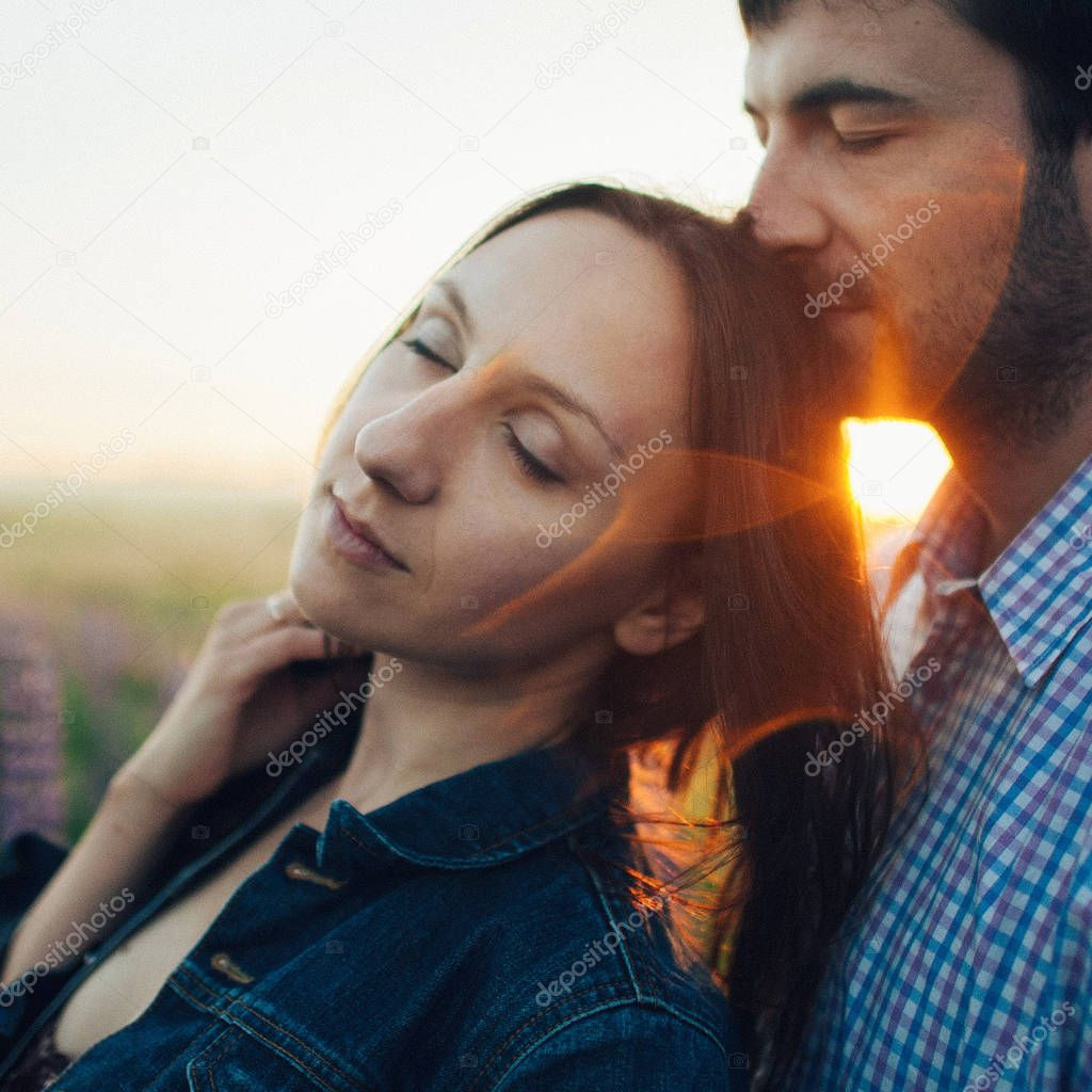 sensual couple outside in sunset