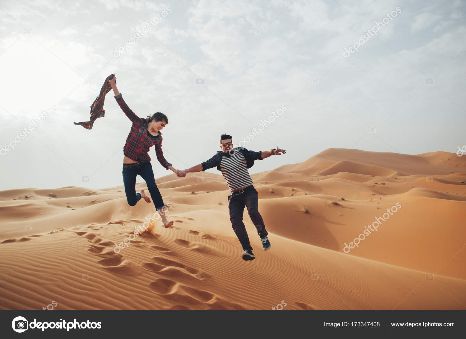 Image of: Stock Couple Of Travelers Having Fun In Desert Sahara Africa Photo By Ladanivskyyo Depositphotos Couple Of Travelers In Desert Sahara Stock Photo Ladanivskyyo
