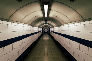 Moody dark tunnel in London Underground