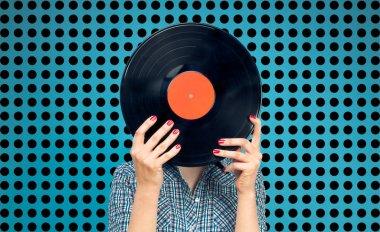 Woman holding a vinyl record
