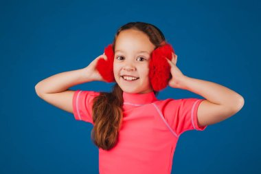 attractive girl with headphones on blue background