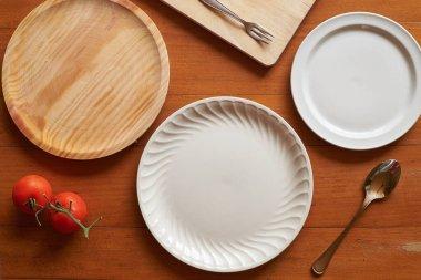 Flat lay of three plates on a mediterranean scene
