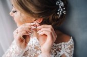 Close-up view of young beautiful bride wearing earring