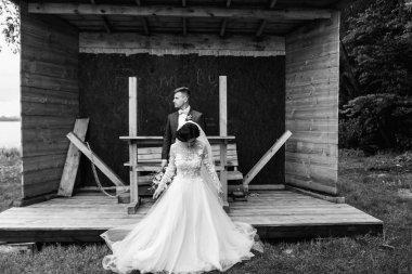 Beautiful wedding couple enjoying romantic moments outdoors