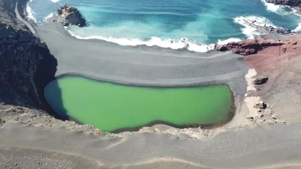 El Golfo green lagoon and ocean with black volcanic beach. Lanzarote.aerial view