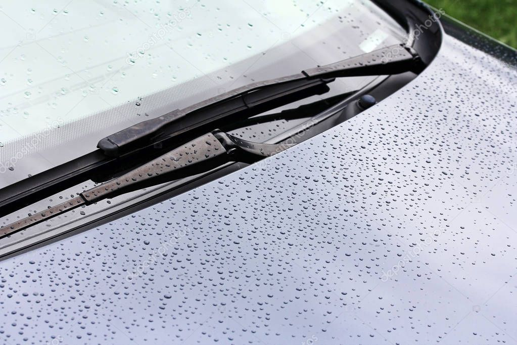 Rainy weather and road traffic. Raindrops on a car