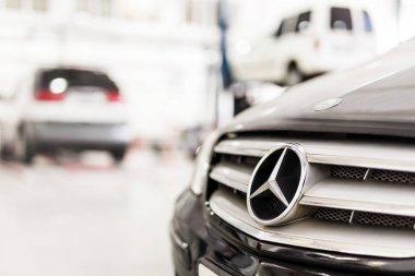 Stuttgart, Germany - December 12, 2017: Close-up Mercedes-Benz car grill at maintenance station. MB vehicle service repair workshop