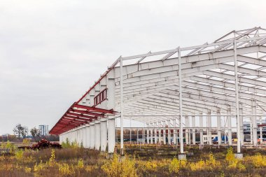 Construction site. Metal structure frame of industrial building