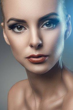 fashion studio portrait of young beautiful woman on dark background
