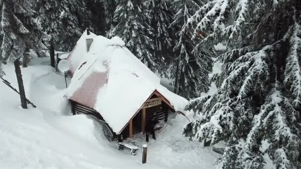 Old snow-covered vintage wooden house in the forest