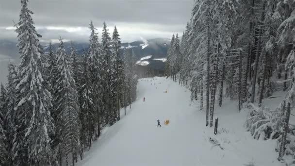 Skiers go down the slope in a ski resort Bukovel, Ukraine. Top view