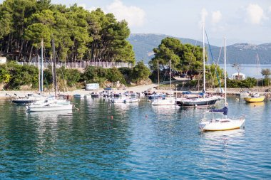 Krk, Croatia - October 3, 2018: Yachts stand on the pier in the port of Krk island.