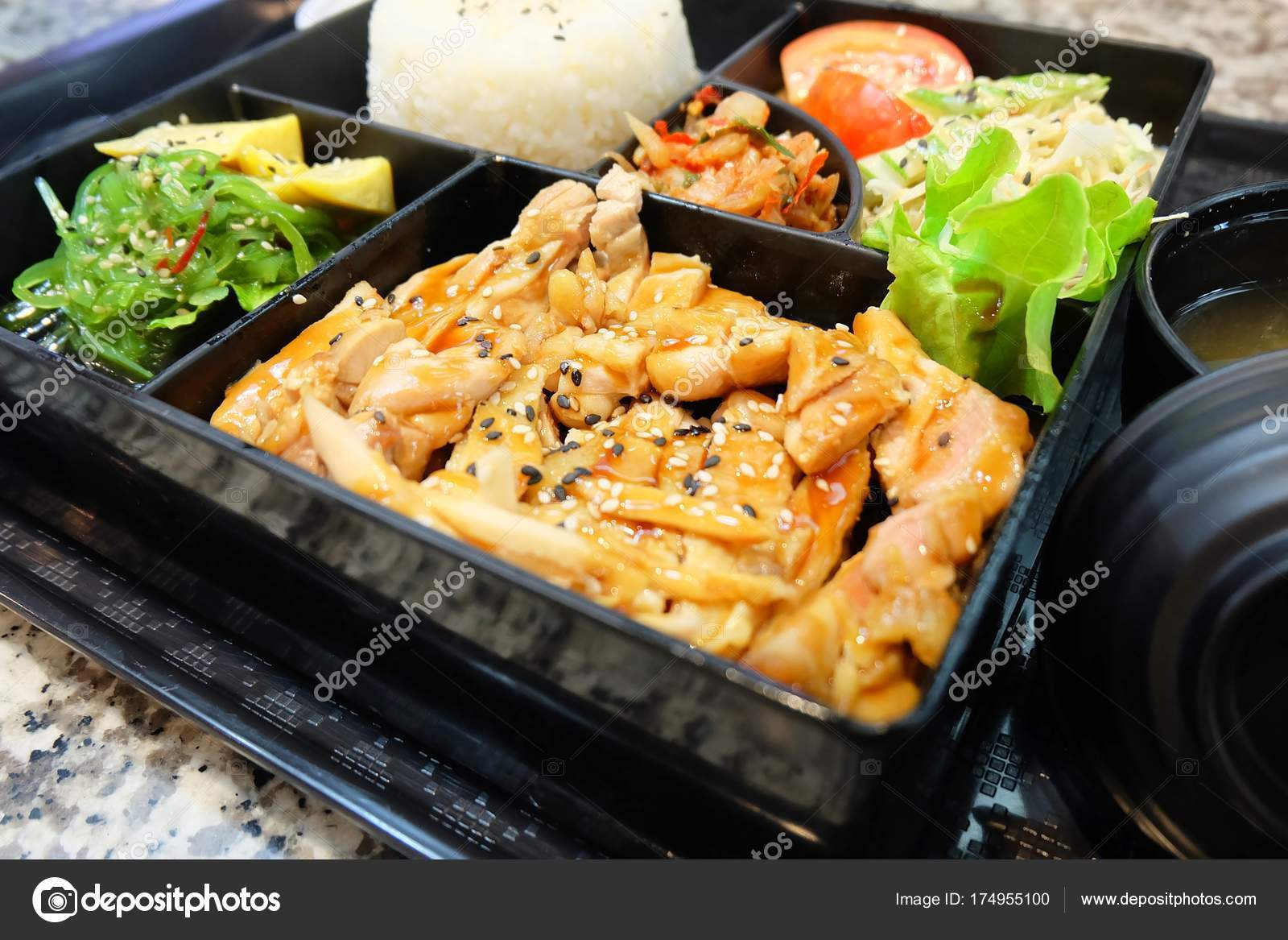 Delicious Japanese Bento Box With Teriyaki Chicken Stock Photo