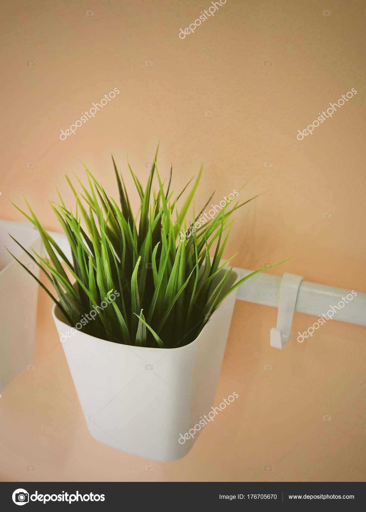 green artificial plant in a white pot — stock photo © arayabandit