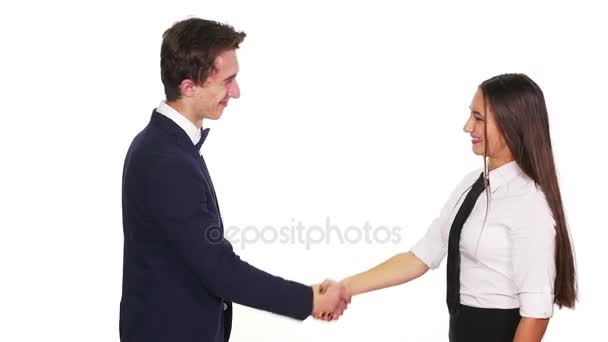 Colleagues shaking hands and grasping hands happily