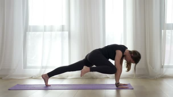 Girl practicing downward facing yoga pose