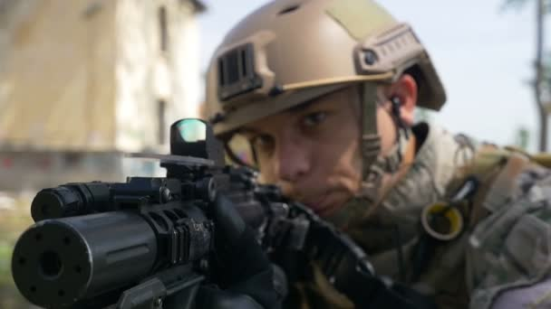 Slow Motion Of Soldier With Gun And Headset Aiming Target In Tactical Operation Ready For Firing