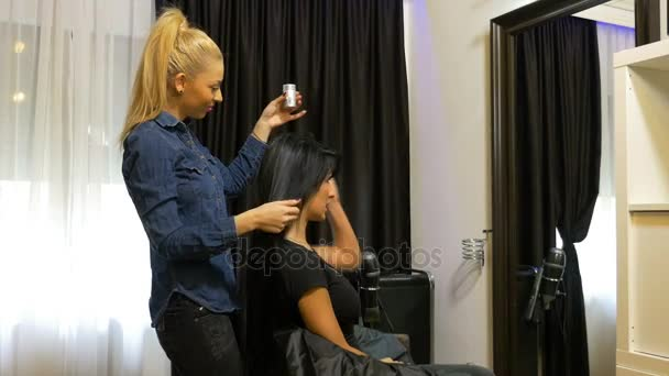 Young woman at beauty parlor getting a new hairdo