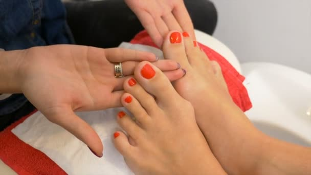 Beautiful pedicure with red nail polish presented for evaluation at ...