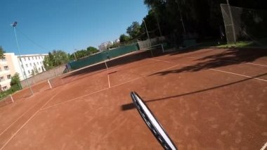 POV serving during tennis game outdoors