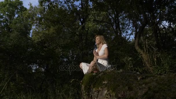 Breathe exercises and yoga in nature in the forest