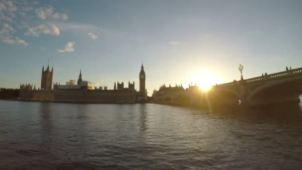 Timelapse of Thames river Big Ben houses of parliament and Westminster bridge at sunset London tourism attraction