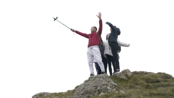 Excited group of tourists having fun taking selfie on mountain top celebrating friendship and freedom