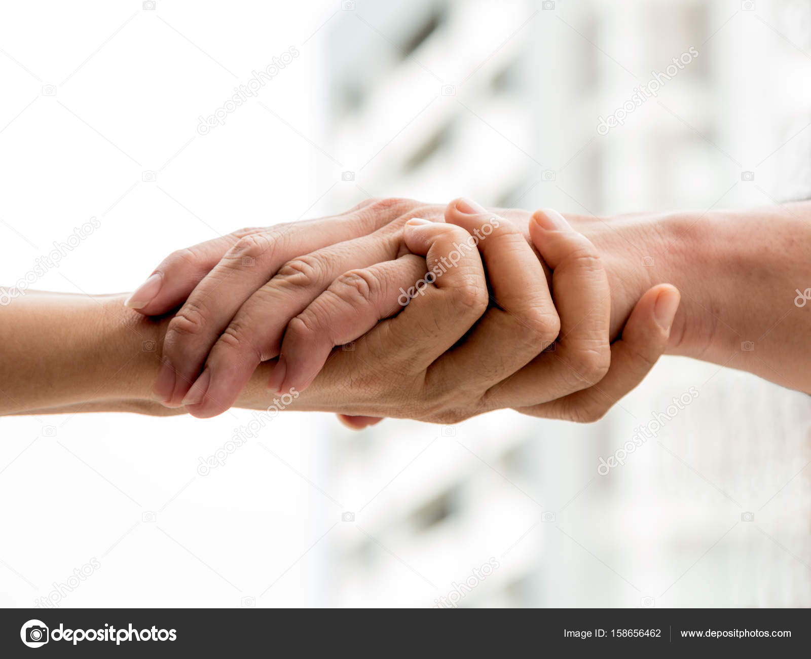Two men holding hand together on light background — Stock ...