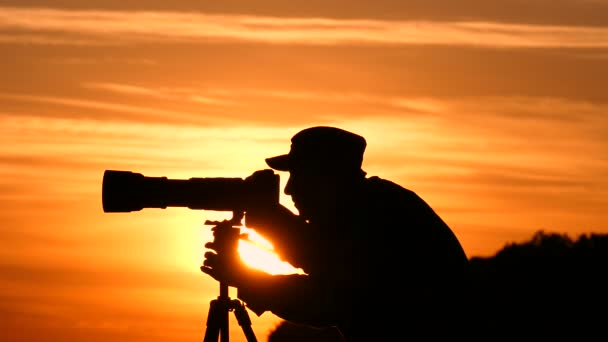 Silhouette of cameraman during the sunset.