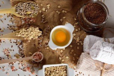 egg yolk, linseed, oatmeal, salt, sunflower seeds for the production of home cosmetics