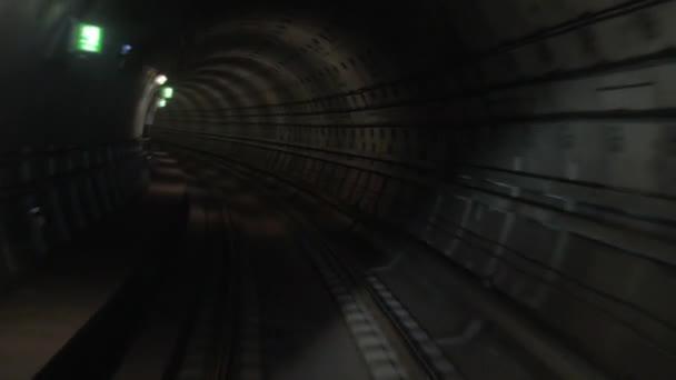 Shot of train goes underground subway.