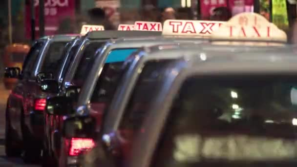 Timelapse of taxi cars waiting for clients in night Hong Kong