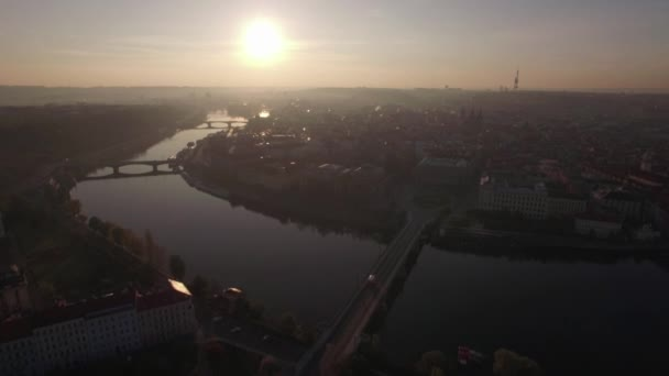 Aerial view of the old part of Prague and bridges over the Vltava river at sunrise. Urban landscape