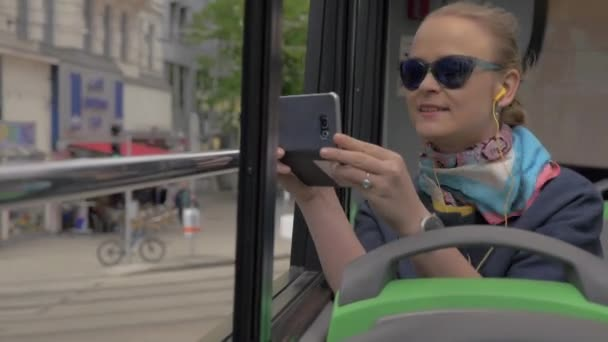 Woman in double-decker bus enjoying city tour