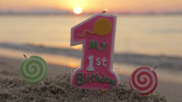 One Year Old Birthday Candle On The Beach Stock Footage