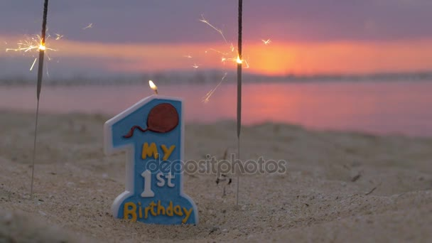 One Year Old Baby Boy Birthday Candle On The Beach Stock Footage