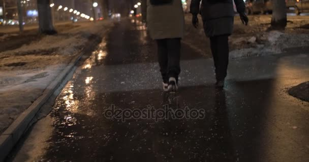 Friends talking during evening walk in winter city