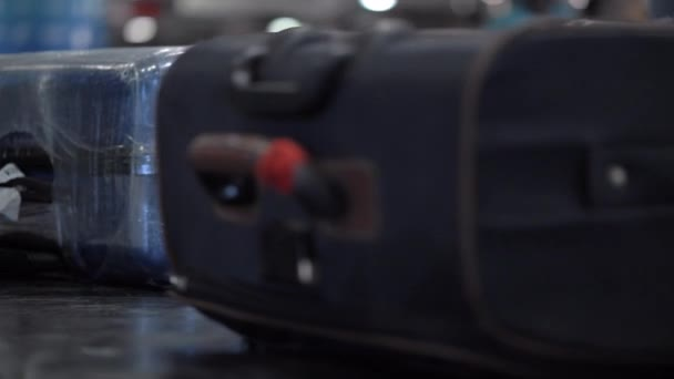 Luggage on moving conveyor at the airport