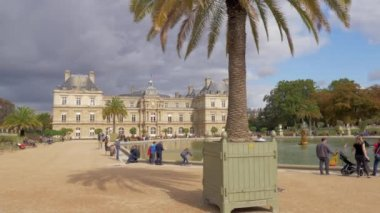 Visitors in Luxembourg Gardens. View with Palace and Pool, Paris