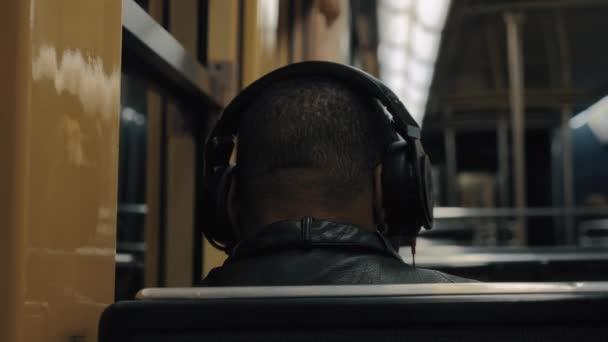 Subway commuter enjoying music during the ride