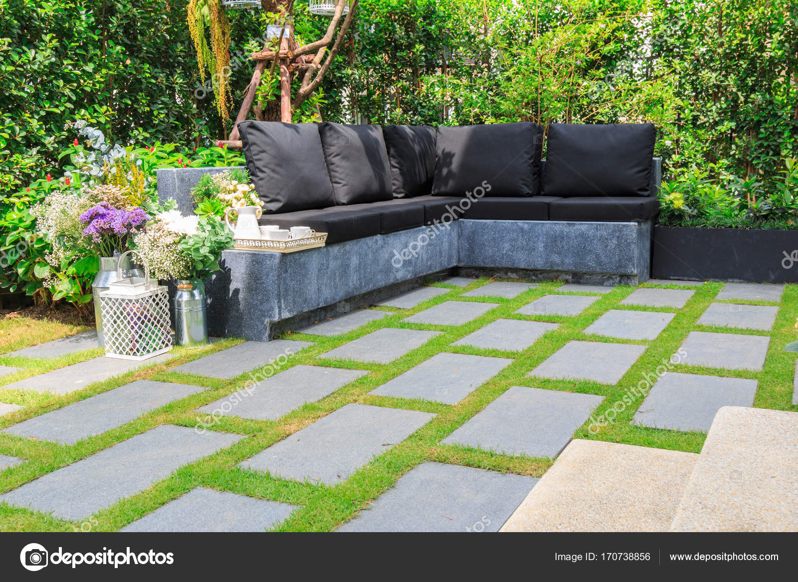 Stone slabs on the grass in the garden stock photo tisomboon stone slabs on the grass in the garden stock photo workwithnaturefo