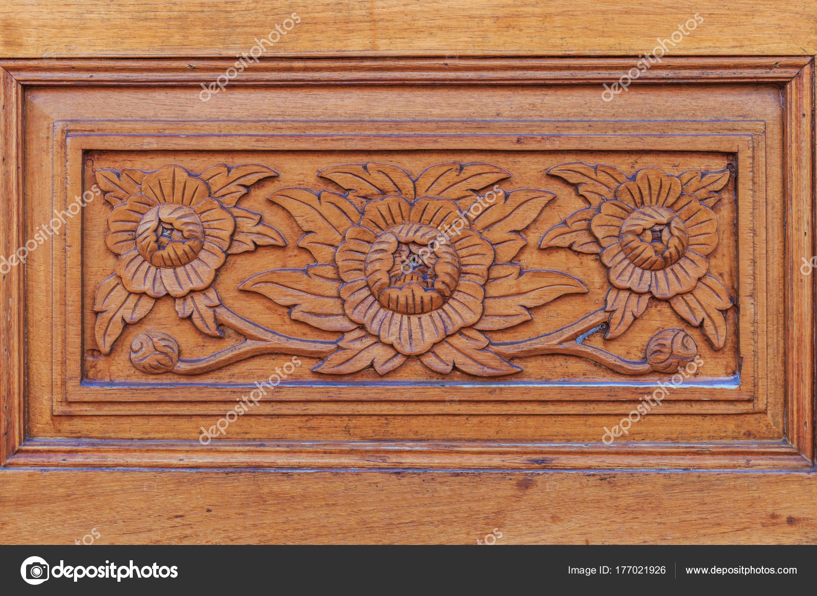 Flower pattern carving with thai style on wooden wall in the tem