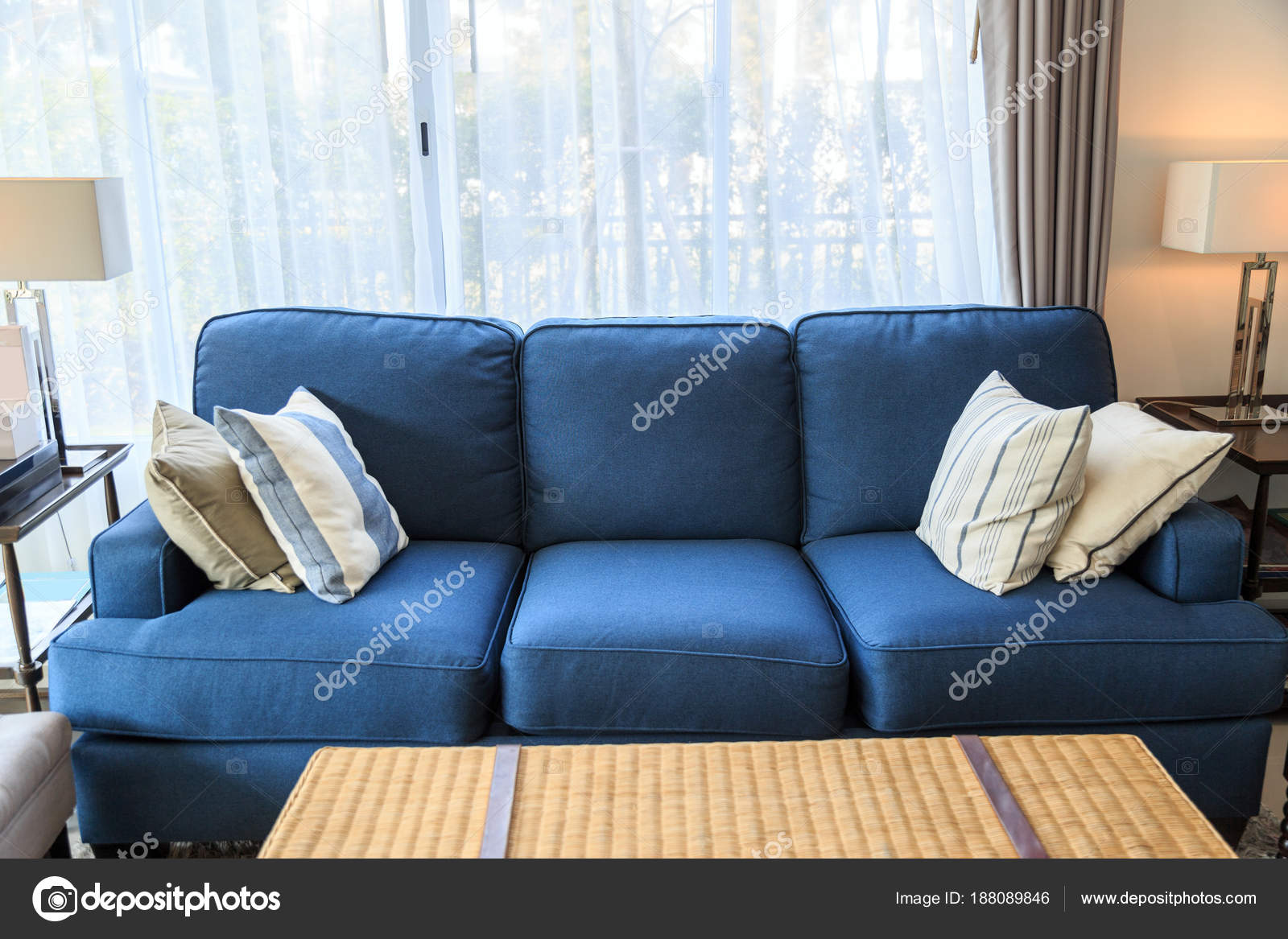 Cuscini Per Divano Blu.A Pillows On A Blue Sofa With Lamp In Livingroom Stock Photo