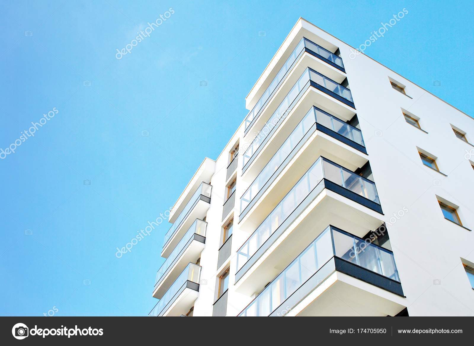 Modern apartment buildings on a sunny day with a blue sky. — Stock ...