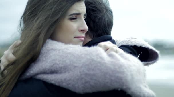 Sad woman in love hugging boyfriend crying slow motion ...