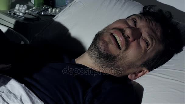 Man crying in hospital bed at night