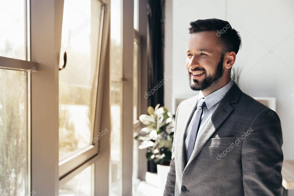 smiling businessman in formal wear