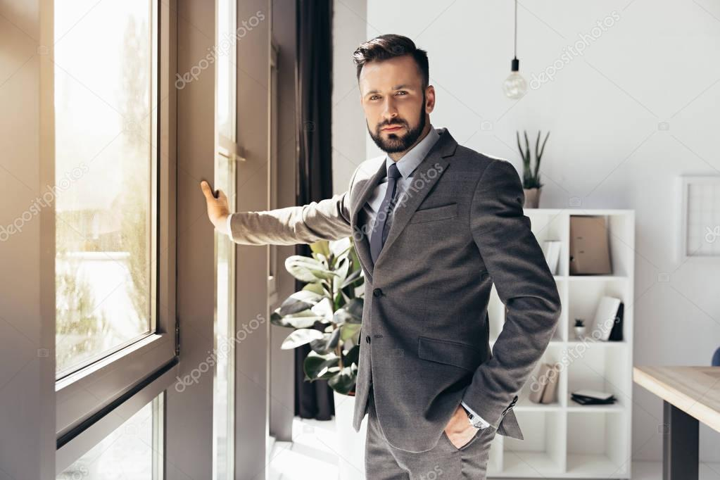 young bearded businessman in suit