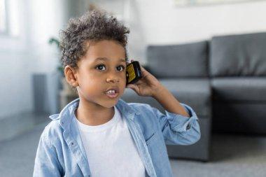 beautiful afro boy talking by phone