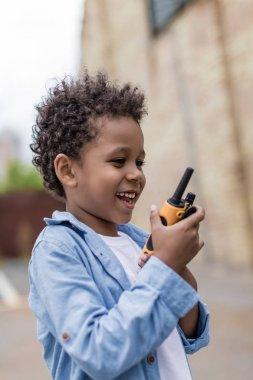 cute boy with portable radio set